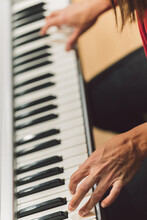 Vertical Photo Of A Woman Playing Electronic Piano