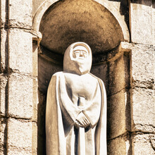 Statue Against Wall Of Building