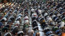 High Angle View Of Men Praying