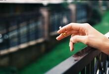 Person Hand Holding Cigarette