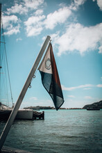 Sailboat Flag On Sea Against Sky