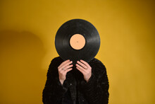 Woman With Turntable Standing Against Colored Background