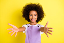 Portrait Of Pretty Kind Careful Cheerful Wavy-haired Girl Hugging You Isolated Over Bright Yellow Color Background