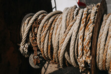 Close-up Of Rope Tied Up Of Rusty Metal