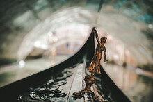 Close-up Of Statue On Boat In Canal