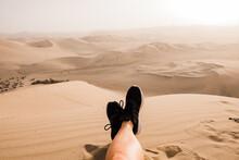 Man Standing On Sand Dunes In Desert