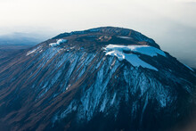 Scenic View Of Snowcapped Mt. Kilimanjaro, Tanzania From The Air.