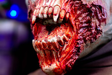 The Bared Fangs Of A Vampire Zombie Covered In Blood