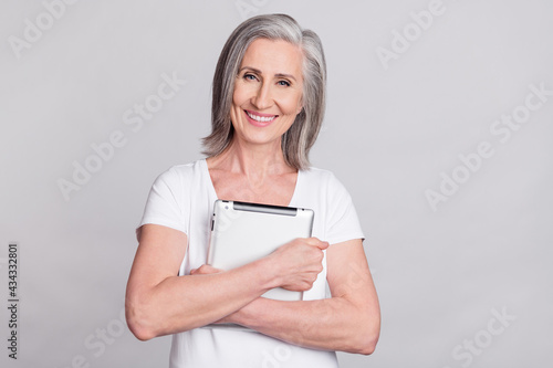 Canvastavla Photo of cheerful senior woman happy positive hug cuddle tablet gadget isolated