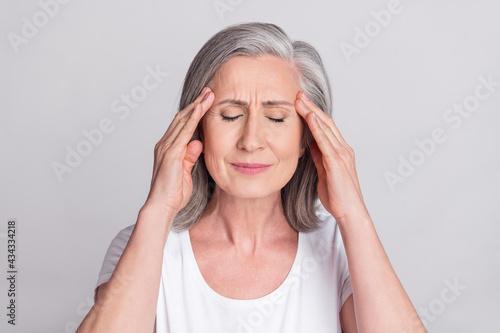 Fotografiet Photo of senior woman hands touch head ache pain suffer ill migraine sick isolat