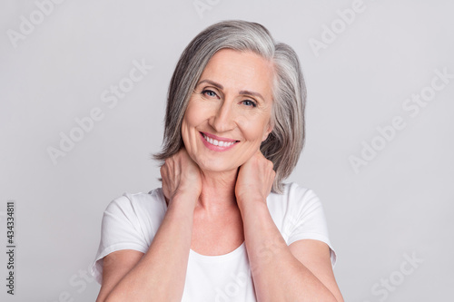 Carta da parati Photo of adorable sweet mature lady wear white clothes arms neck smiling isolate