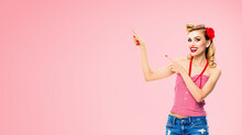 Amazed Happy Woman Pointing At Something. Excited Girl In Pin Up, Showing Product Or Copy Space For Text. Retro Fashion And Vintage. Isolated Over Rose Pink Color Background.