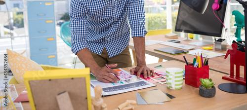 Fotografia, Obraz Male graphic designer working at desk