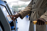 Fototapeta Kawa jest smaczna - Black Traveler Man Using Self Check-in Machine Kiosk Service At Airport, Finger Point On Display.