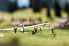 Group Of Miniature Figure Standing On A Field