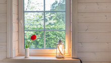 White Window With Mosquito Net In A Rustic Wooden House Overlooking Blooming Spring Garden, Pine Forest.