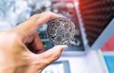 Fototapeta Kawa jest smaczna - hand with metal object printed on 3d printer close-up