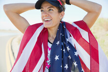 Female Athlete With American Flag Around Her Neck
