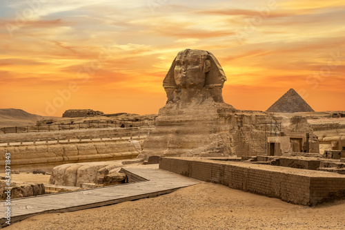 Stampa su Tela Landscape with Egyptian pyramids, Great Sphinx and silhouettes Ancient symbols and landmarks of Egypt for your travel concept to Africa in golden sunlight