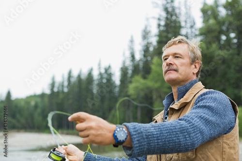 Fotografie, Tablou Mature man fly fishing