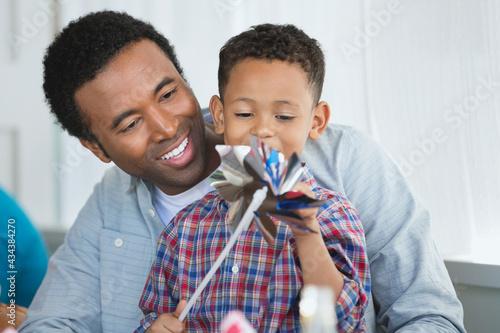 Fotografia, Obraz Happy father and son with pinwheel