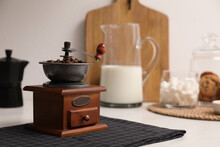 Vintage Manual Coffee Grinder With Beans On Counter In Kitchen
