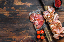 Meat Antipasto Board, Pancetta, Salami, Sliced Ham, Sausage, Prosciutto, Bacon With Grape And Parmesan Cheese. Wooden Background. Top View. Copy Space