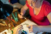 Soldering The Stained Glass Window, Woman Is Making A Stained Glass, Soldering The Stained Glass Window