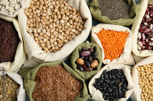 Fotografia Different grains and seeds as background, top view. Veggie diet