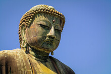 Low Angle View Of Statue Against Clear Blue Sky At Great Buddha Statue, Kamakura, Kanagawa, Japan