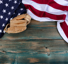 US Flag With American Baseball And Glove On Faded Blue Wooden Planks For Sport Concept
