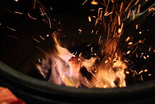 High Angle View Of Wood Burning In Fire Pit