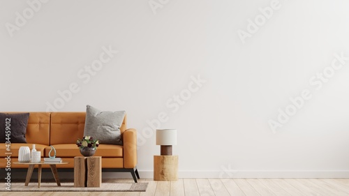 Living room interior wall mockup in warm tones with leather sofa on white wall background.