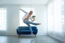 Handsome Young Male Ballet Dancer Practice With Flowers Bouquet In His Room, Social Distance During Quarantine Lifestyle