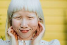 Cute Albino Girl Listening To Her Favorite Music Through Earphones