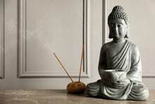 Buddha Statue And Incense Sticks On Grey Table. Space For Text