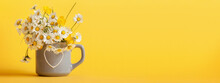 Bouquet Of Daisy Flowers In Gray Cup On Yellow Background. Spring Still Life With Little Chamomile. Banner.