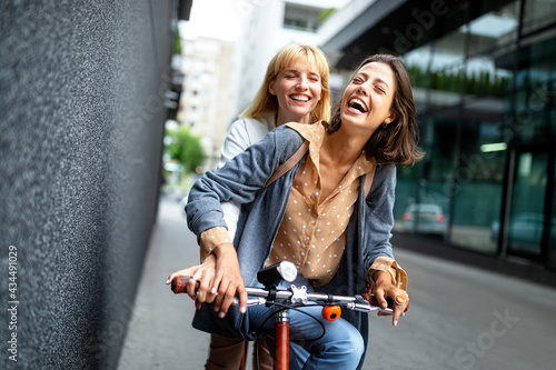 Fotografiet Beautiful happy women friends having fun and good time together outdoor