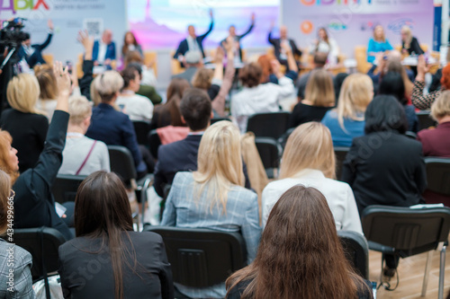 Group of businesspeople raising hands during conference #434499666