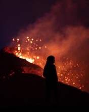 View Of A Person In Silhouette With Lava Eruption From A Volcano In Geldingadalur, Iceland.