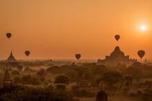 Hot Air Balloons Fly Over Dhammayan Gyi And Sulamani Temple In Bagan, Myanmar At Sunrise.