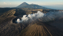Drone View Of Mount Gunung Bromo Volcano In East Java, Indonesia. Mount Bromo Is Active Volcano In Clouds Of Smoke With Crater In Depth