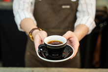 Close-up Shot Of Barista Serving Hot Coffee To Customer In Coffee Shop