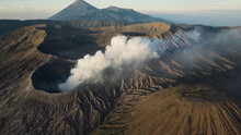 Smoke Out Of Crater Of Volcano In Indonesia. High Angle View Of Mount Bromo As Active Volcano In East Java, Indonesia.