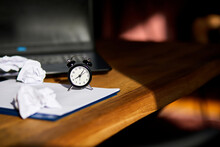 Modern Workplace, Wooden Office Desk In Hardlight, Sunligt With Clock, Sheet Of Paper