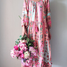 Midsection Of Woman Standing Holding Bouquet Of Pink Flowers