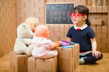 Young Girl Pretend Play As A Teacher At Home
