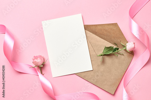Fotografie, Obraz Greeting card with envelope, pink ribbon and rose flower, mockup with copy space