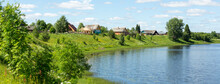 Beautiful Rural Landscape. Small Village By The Lake On A Sunny Summer Day.