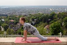Man Doing Tai Chi Exercises At Outdoor.